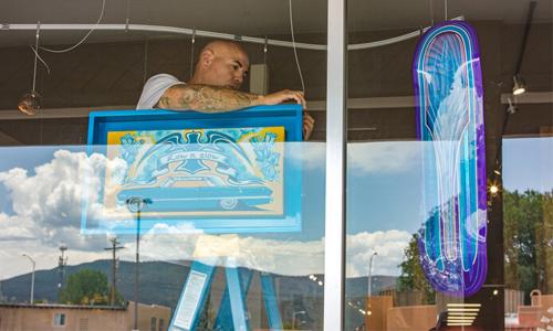 Artist behind a window fixing public art installations